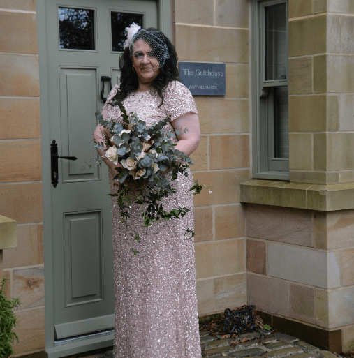 Dawn outside The Gatehouse in Whitby on her wedding day