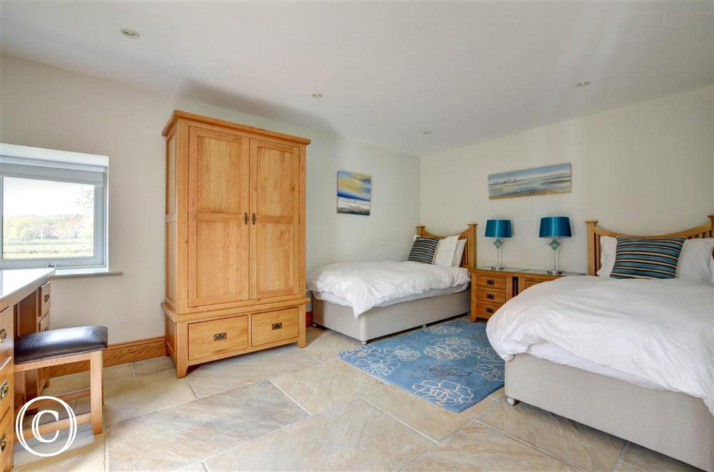 Bedroom 1 has twin beds, is on the ground floor and is suitable for wheelchairs.