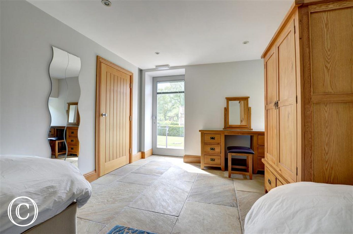 Bedroom 1 is spacious and has a French door allowing acess directly from the outside.