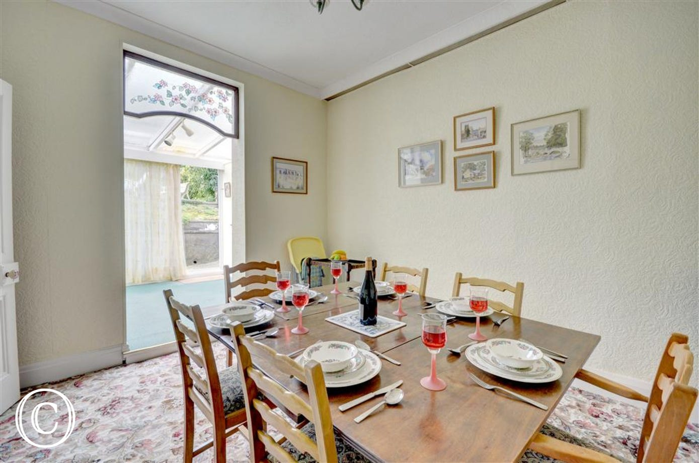 Dining Room adjoins the Utility Area with the access to the back garden.