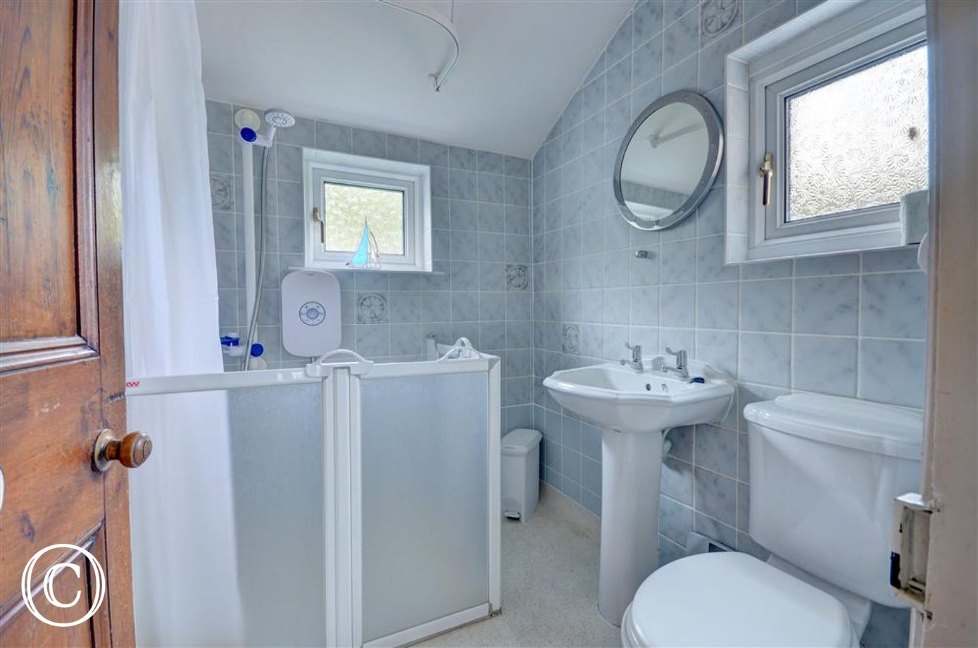 Wet Room has walk-in shower with a seat, toilet and washbasin.