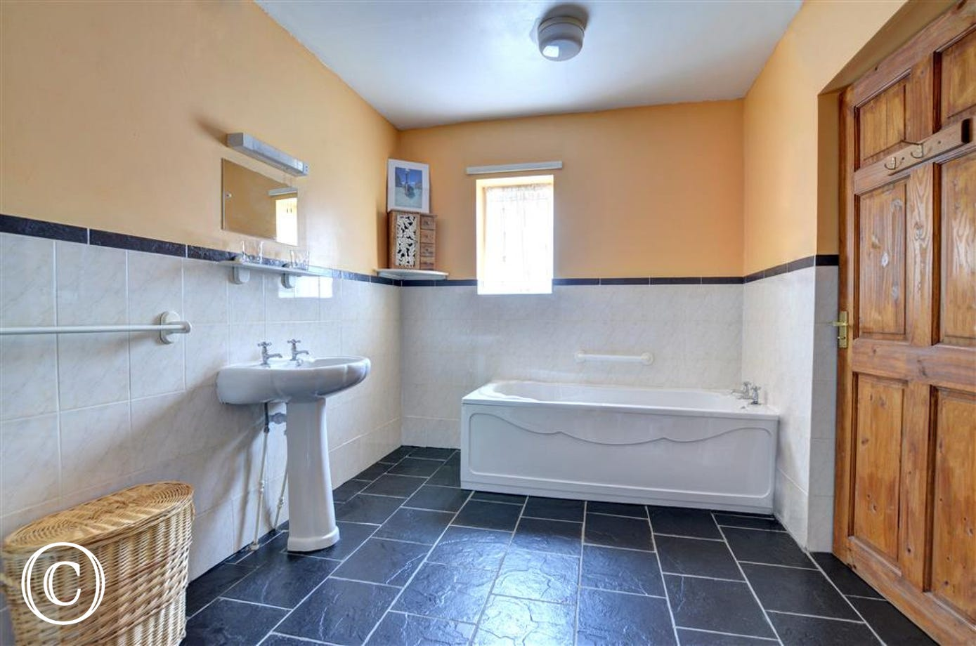Family bathroom has a bath and is very spacious.