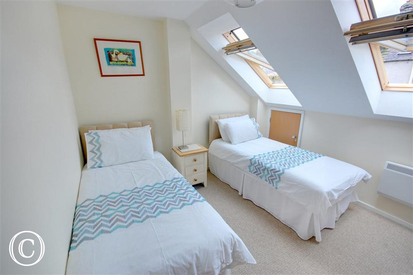 Bright and airy third Bedroom with three single beds. The Velux windows let plenty of light into this room.