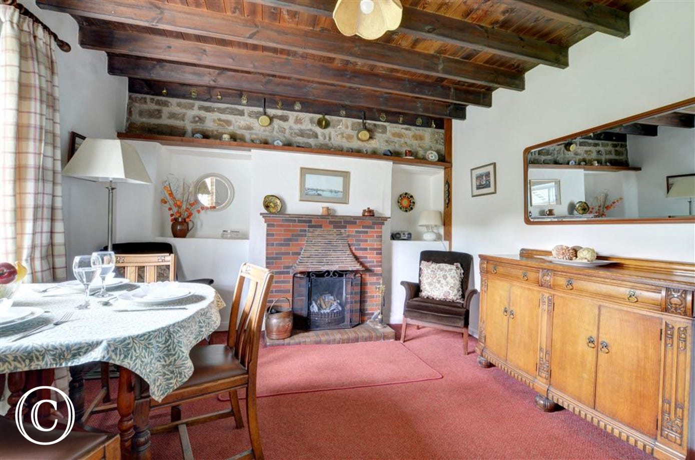 The dining room has a cosy feature fireplace.