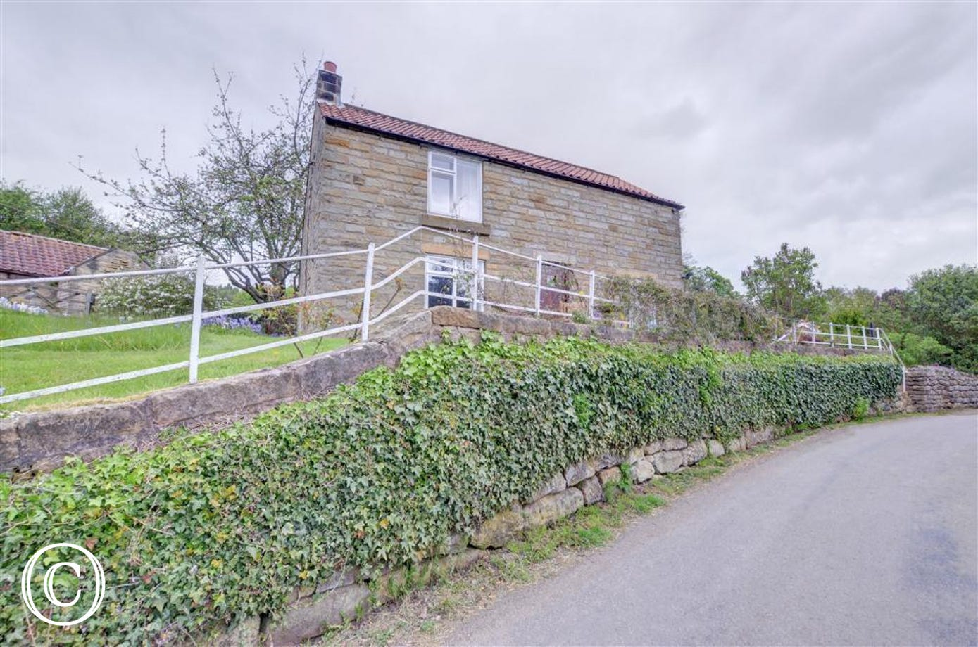 Rockley Cottage is accessed via a flight of steps to the right hand side of the property.