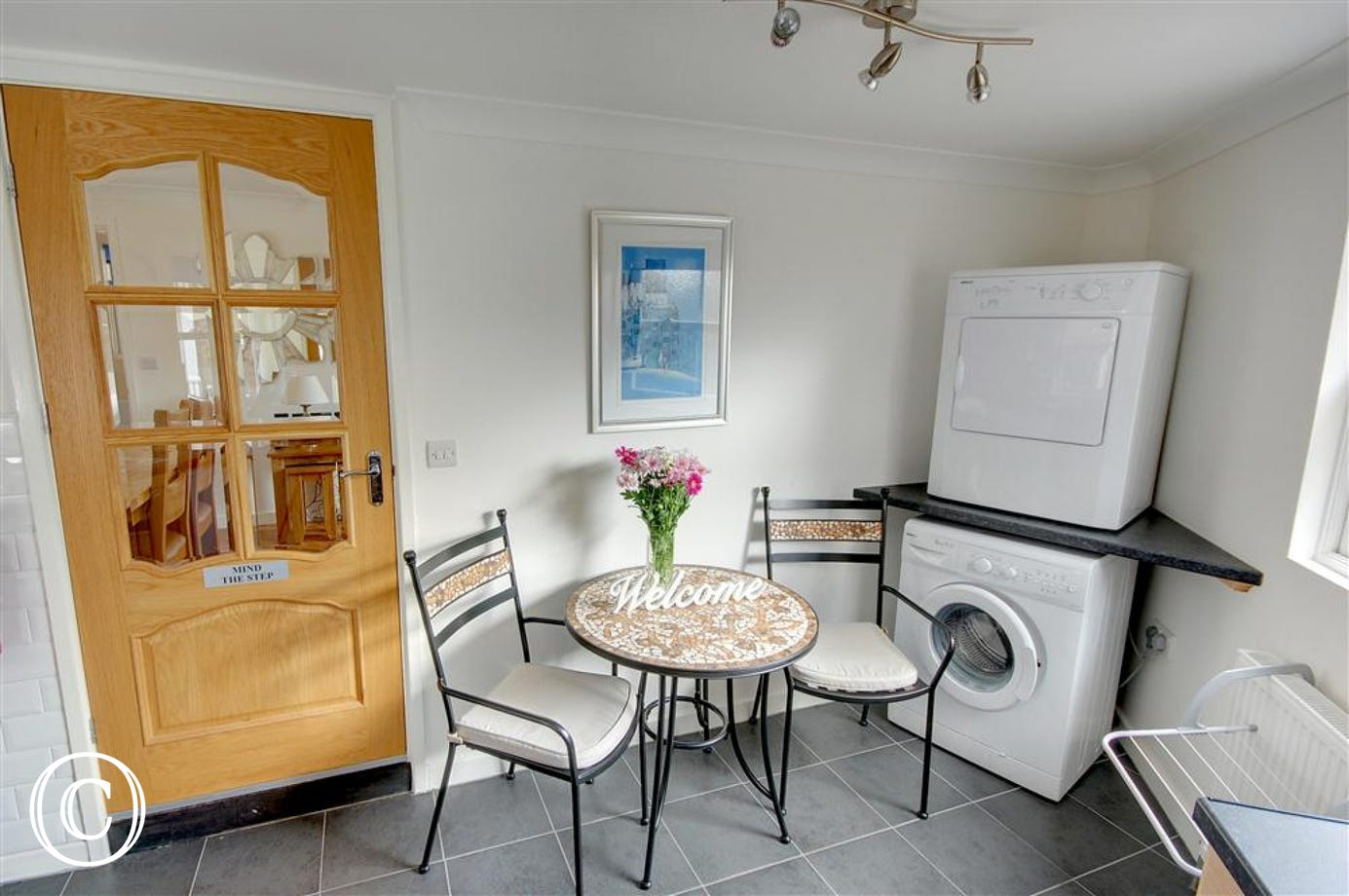 The Kitchen has a small breakfast table and chairs along with washing/drying facilities.