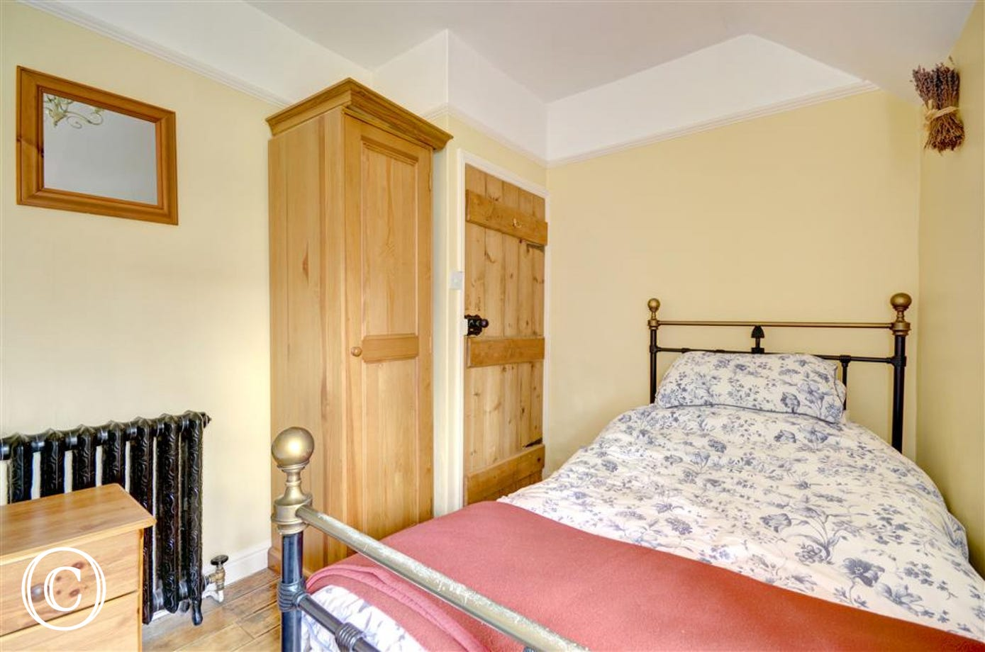 Two single beds in this cosy second bedroom.
