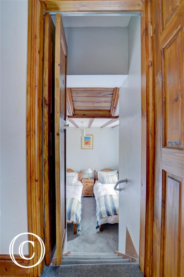 A folding door and small set of steps take you to bedroom 2.