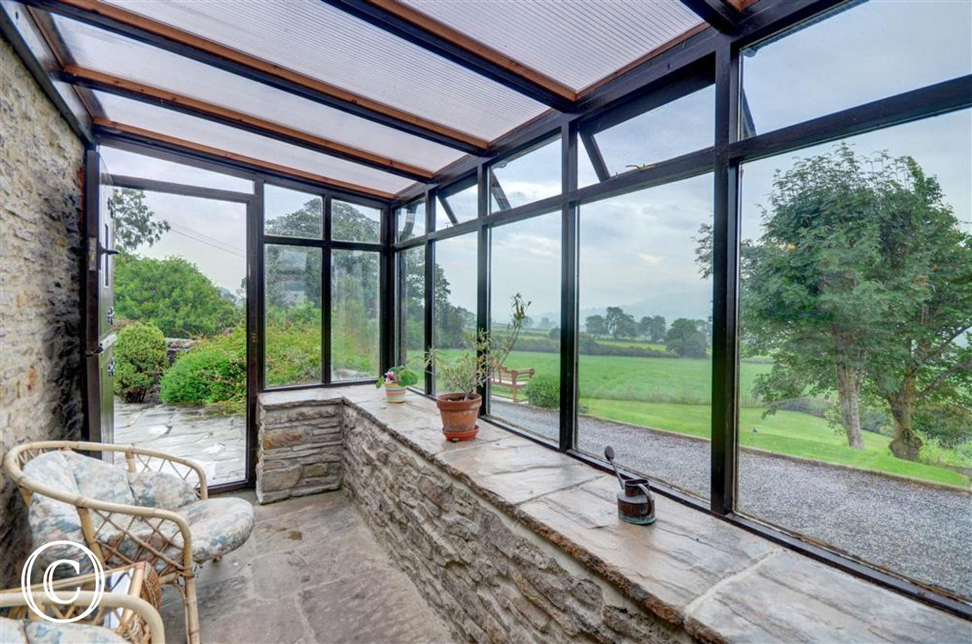 The conservatory at Field Cottage which overlooks the stunning countryside