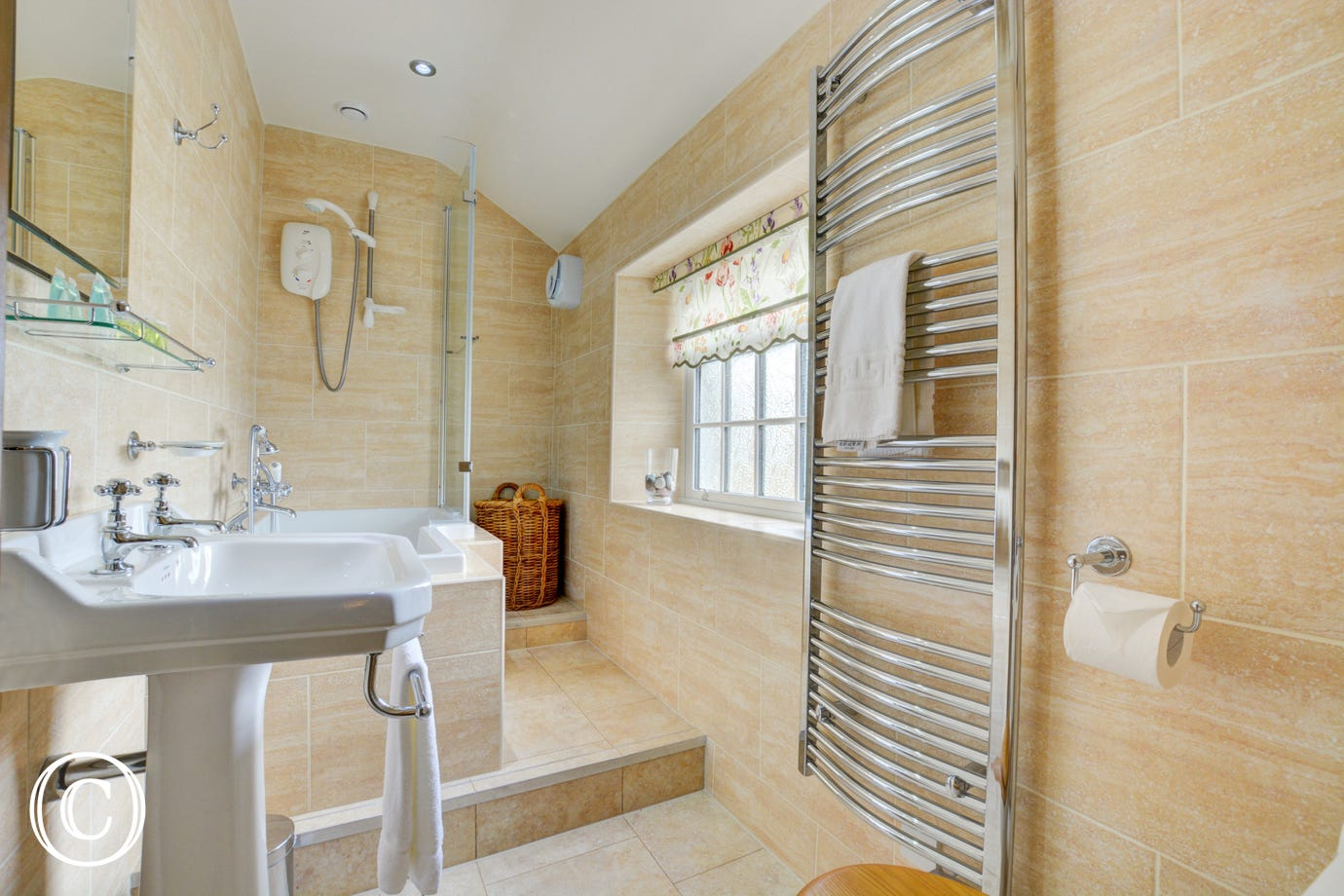 House bathroom with bath and shower over