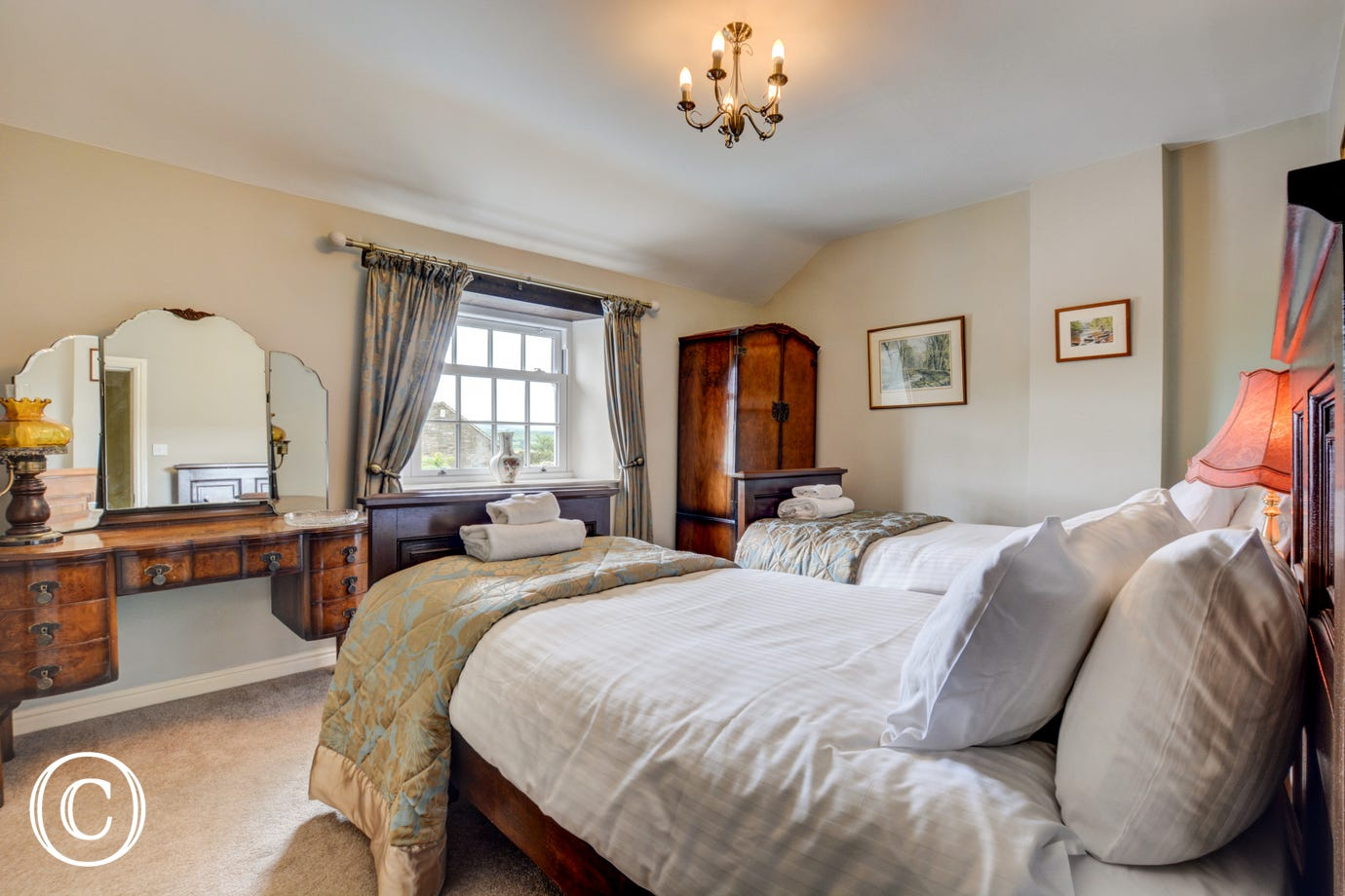 Bedroom three with twin beds and views towards Middleham and Pen Hill