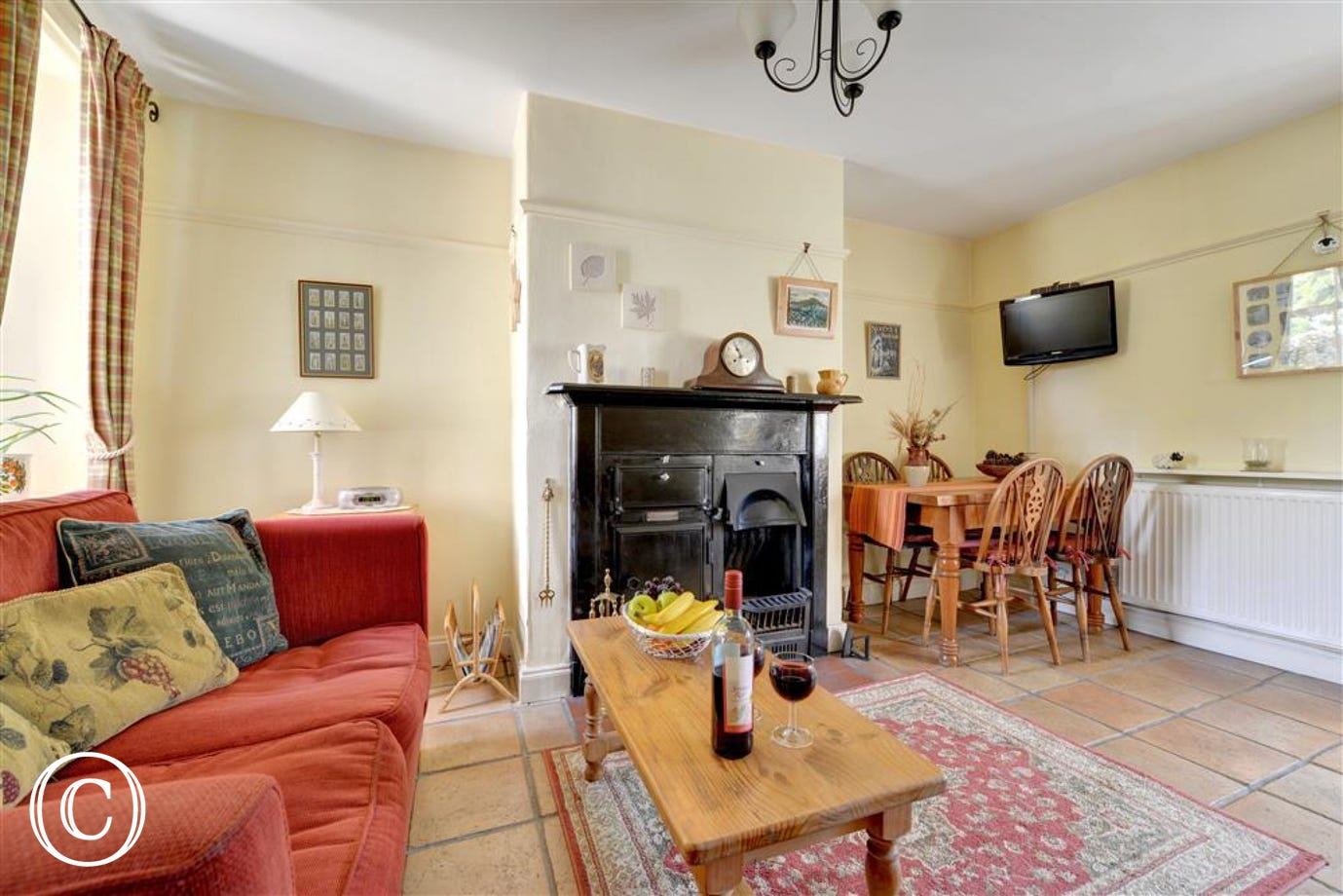 Lounge / diner with TV and original Yorkshire range with  open fire.