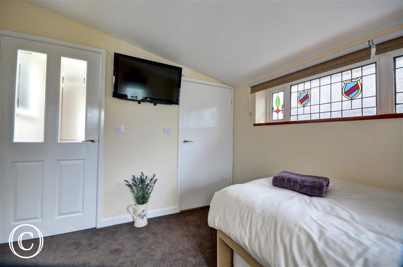 Bedroom 3 has a single bed, TV and En suite