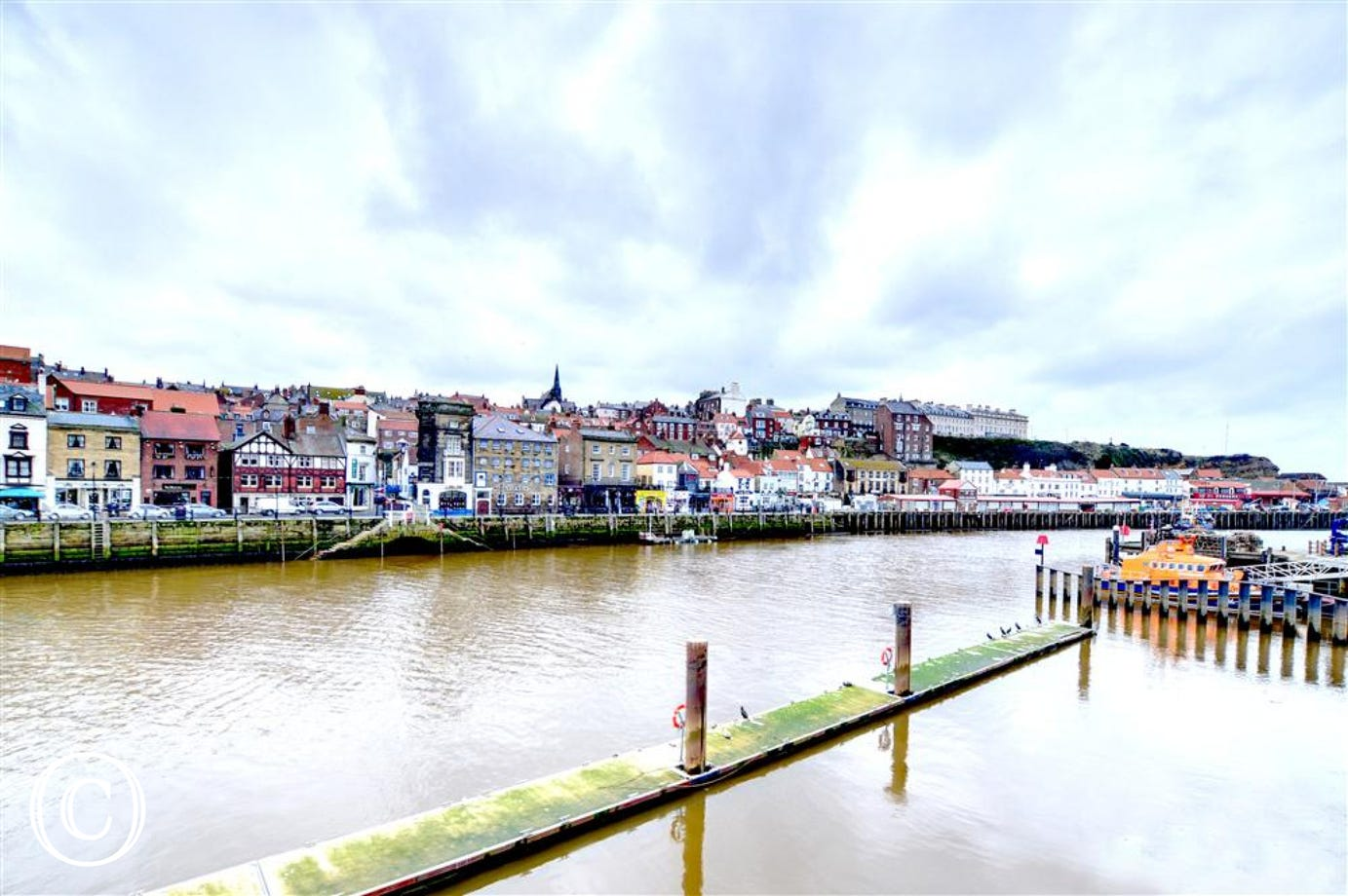 Extensive views of Whitby's West side on the opposite side of the River Esk.