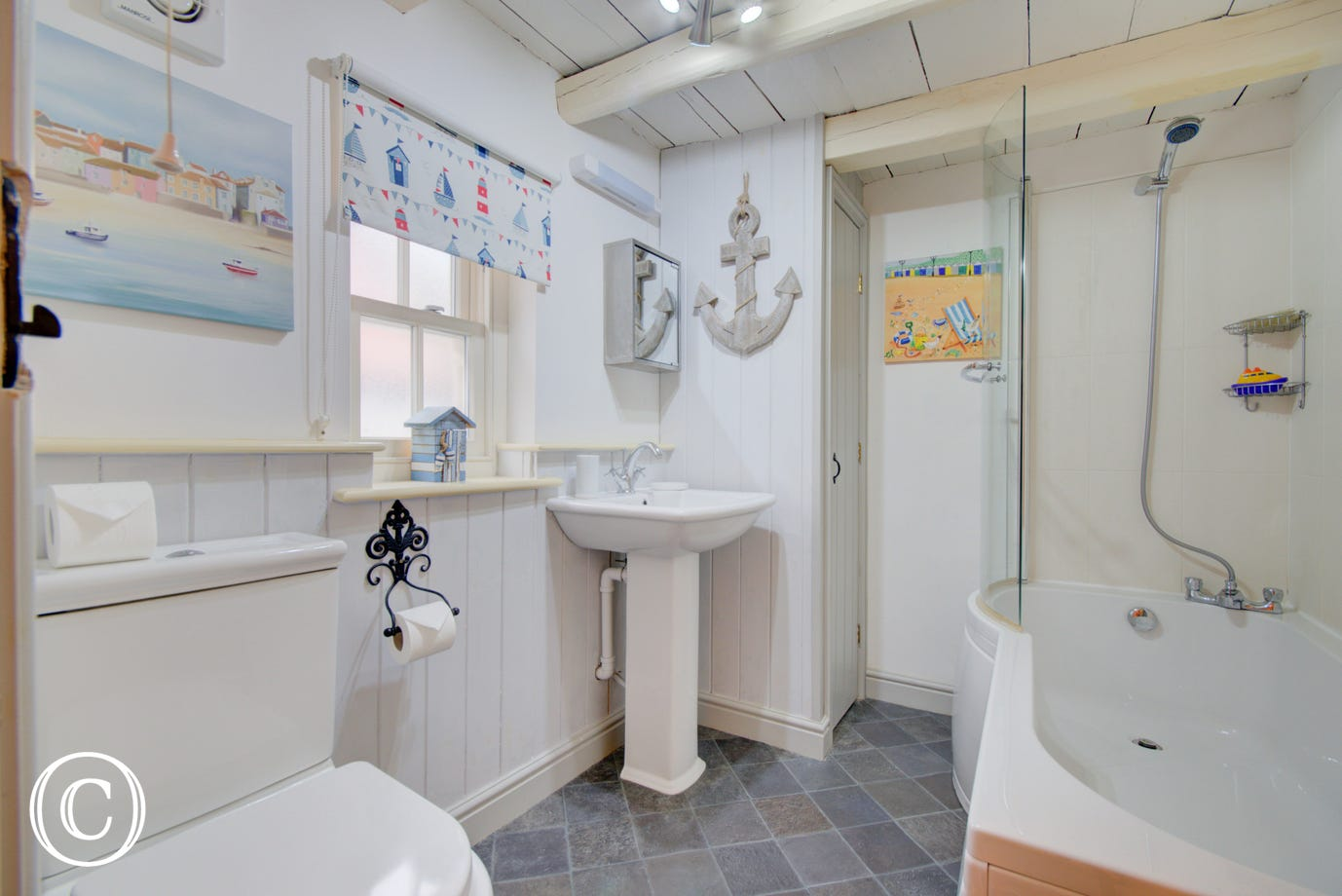 Family Bathroom on the first floor with bath and shower over the bath.
