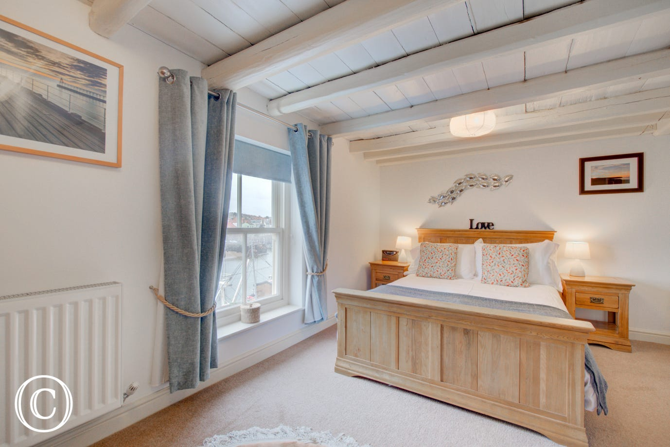 Characterful double Bedroom with beamed ceiling and stunning window views.