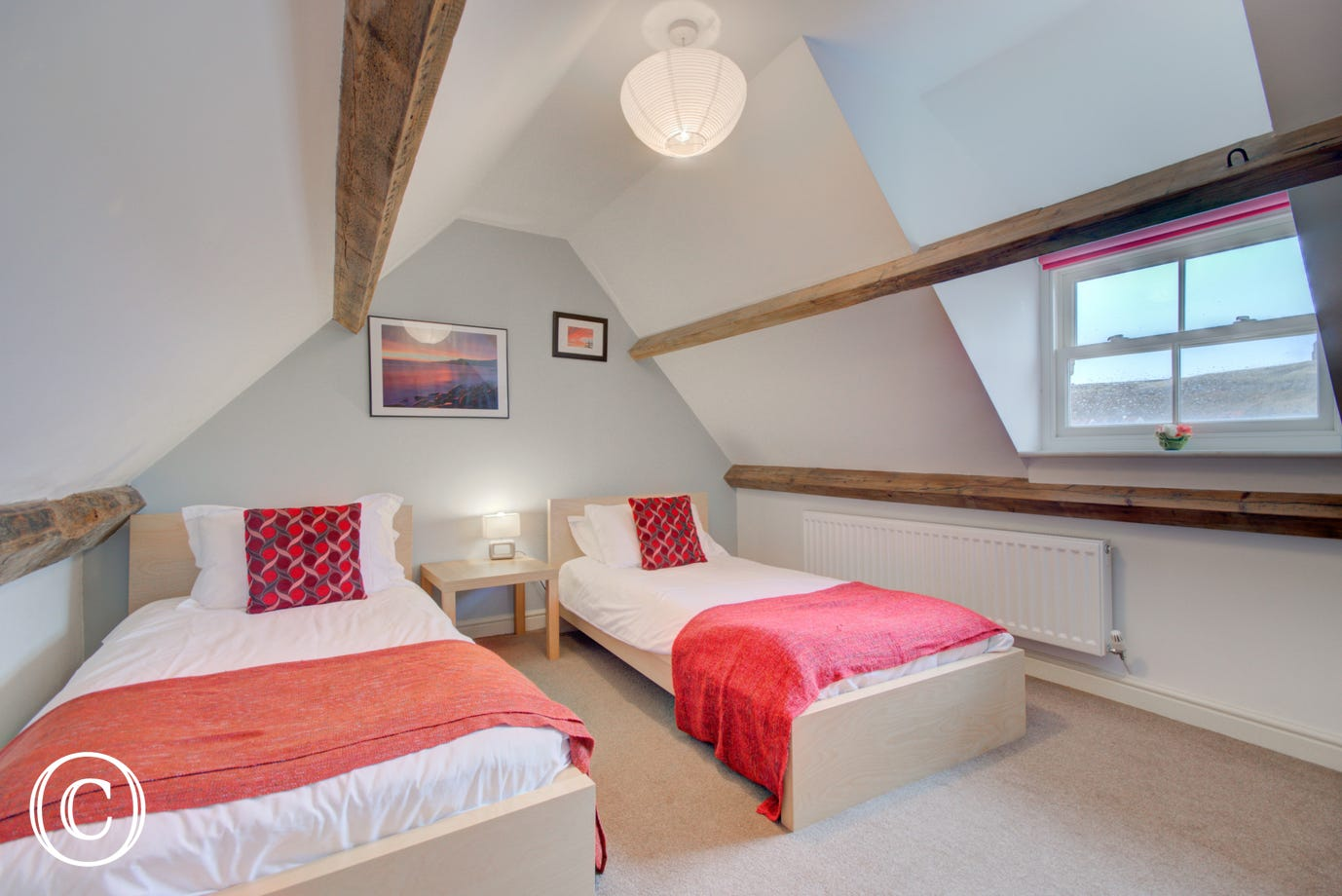 Twin Bedroom with single beds on the second floor. The dormer window provides plenty of light.