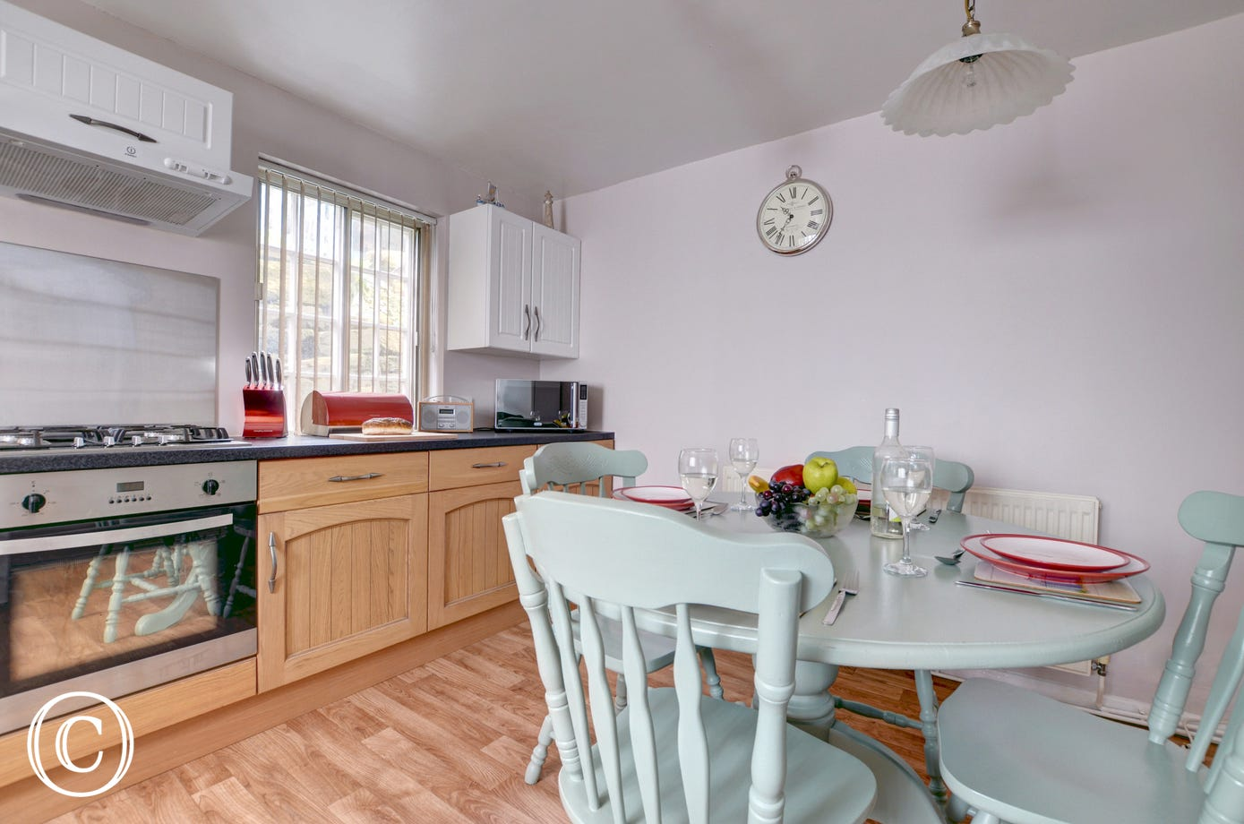 The kitchen has a dining table and chairs for four people.