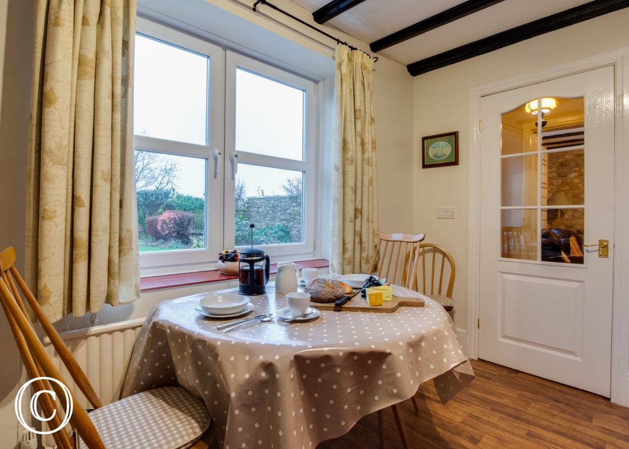 Dining area of the kitchen with views over the rear garden