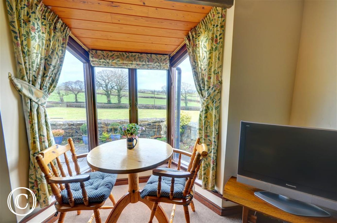 Dining area in the conservatory with open countryside views.