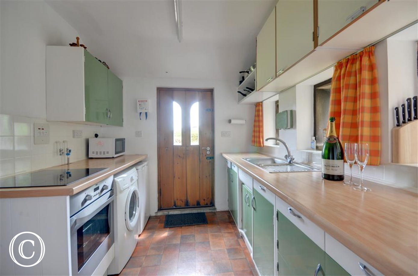 Kitchen is modern and well equipped.