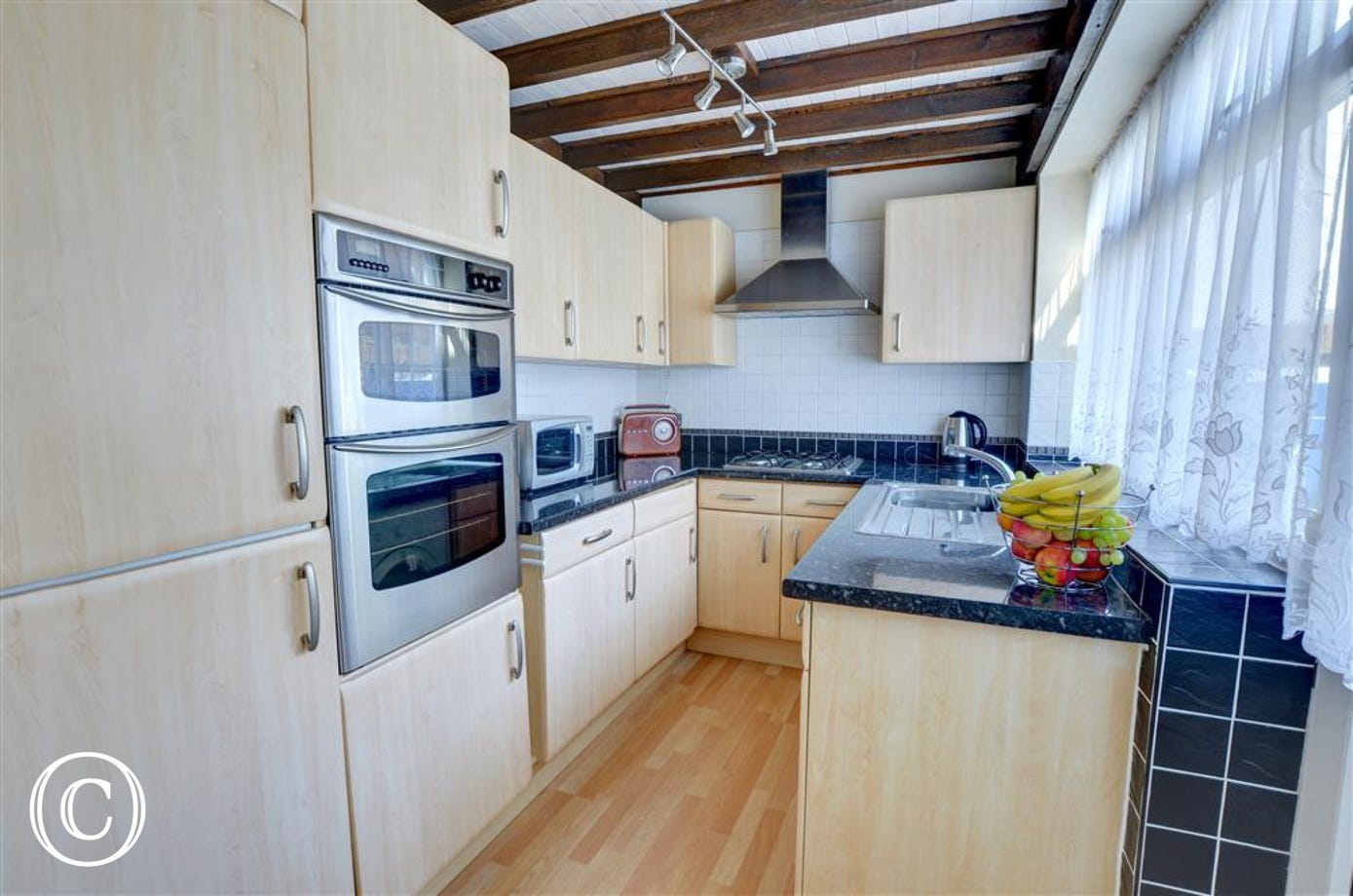 Kitchen has high quality units and appliances.