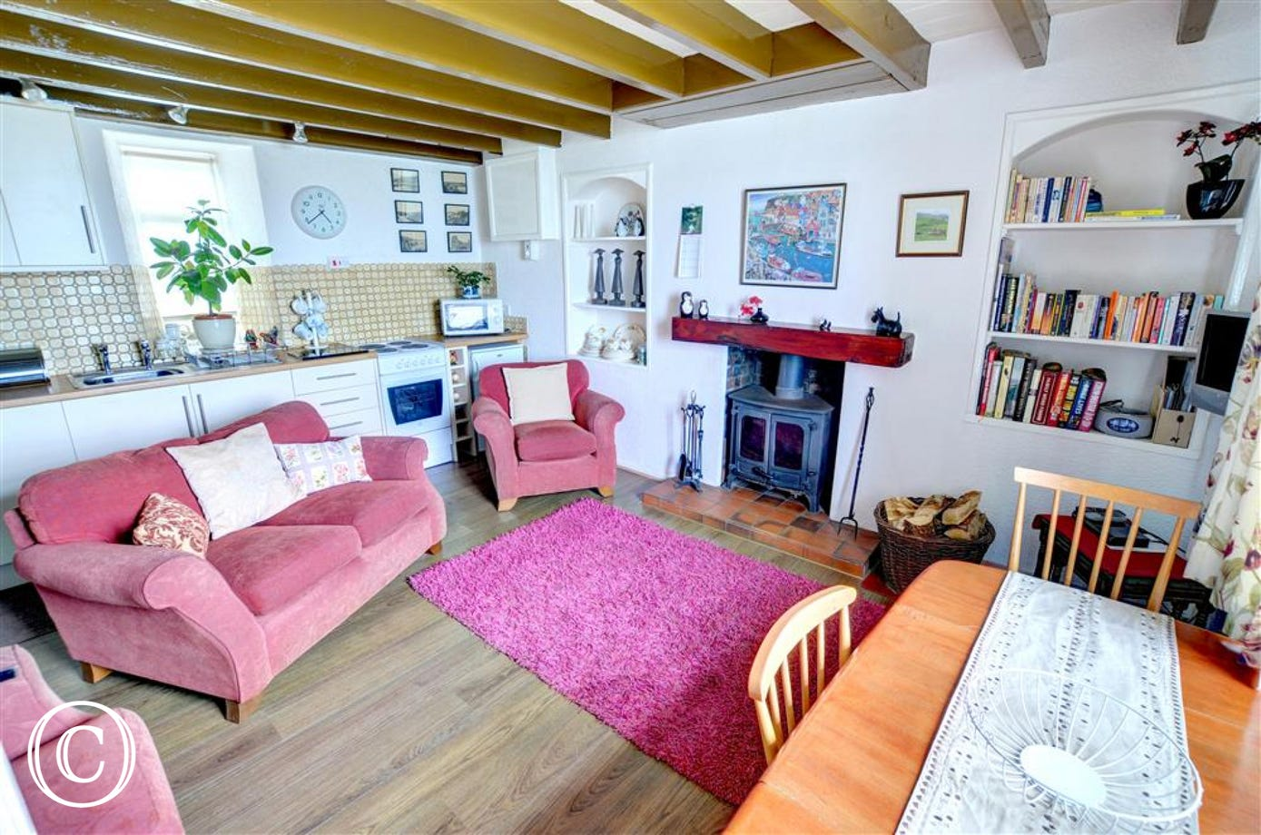Characterful and cosy Lounge/Kitchen/Diner with wood-burning stove.