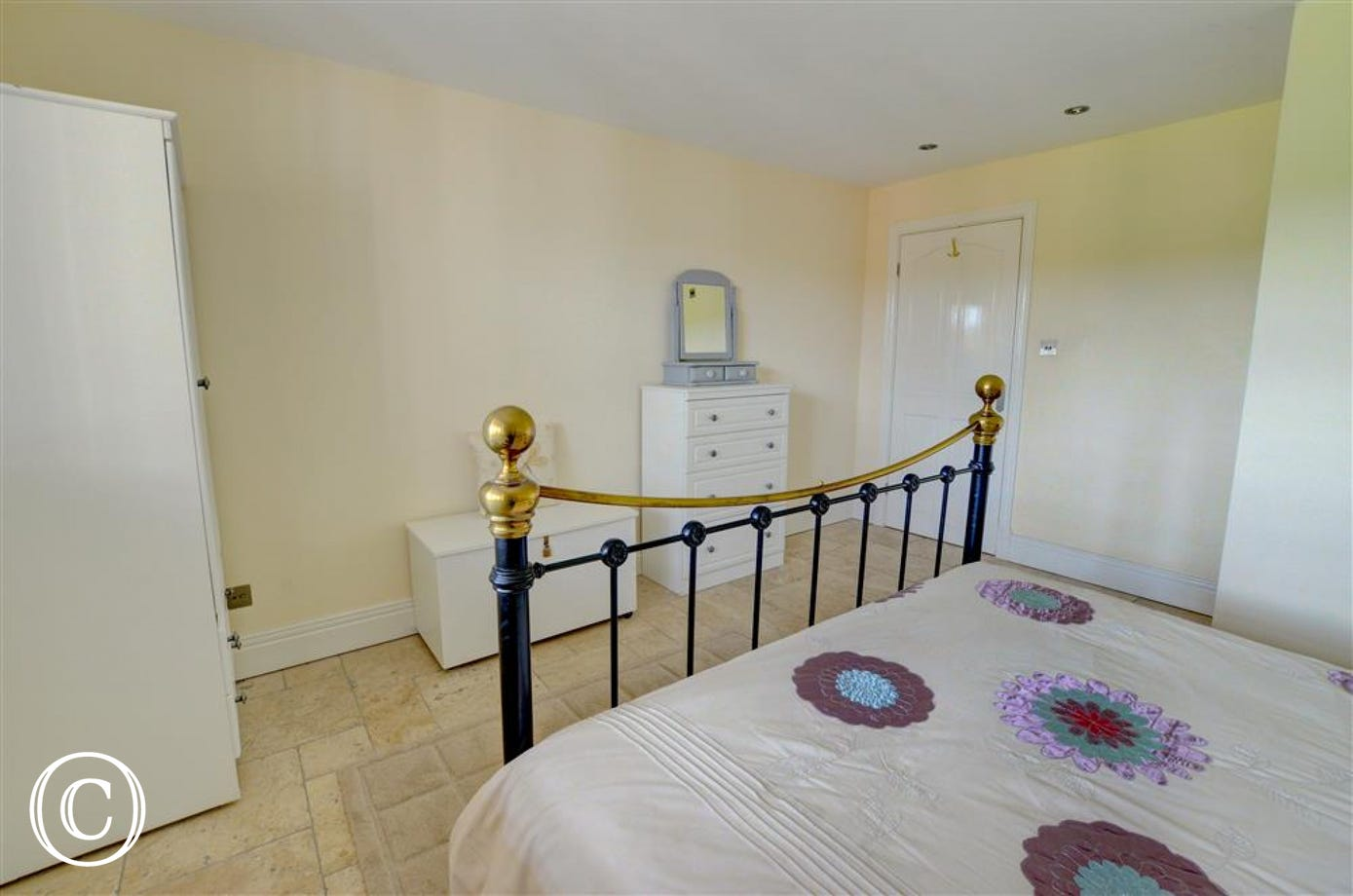 The Bedroom has plenty of furniture and storage area and also features an En-suite,