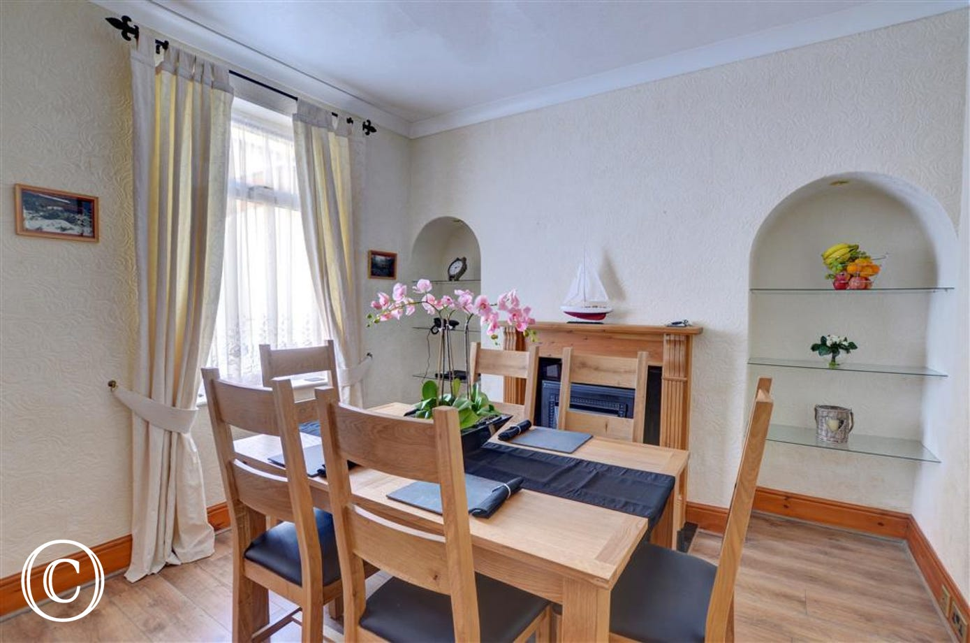 Spacious dining room with a dining table and chairs.