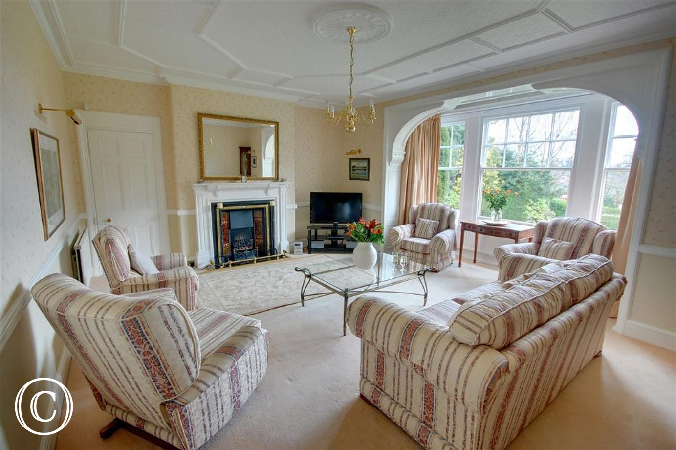 The Lounge is situated at the front of the property and includes a feature fireplace.