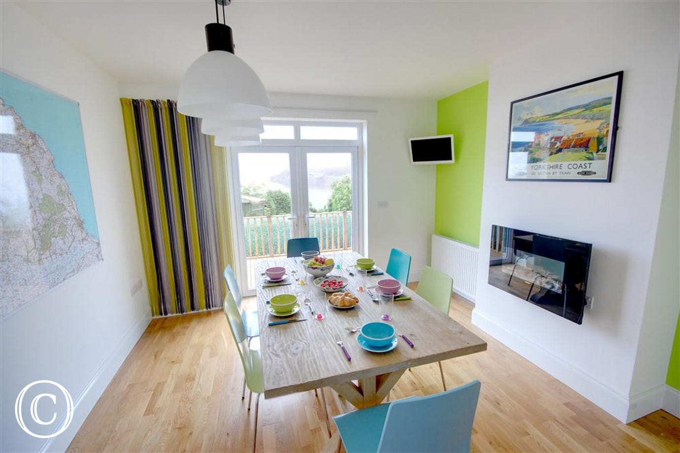 Colourful Dining Area which also gives further access to the outside decking and garden.