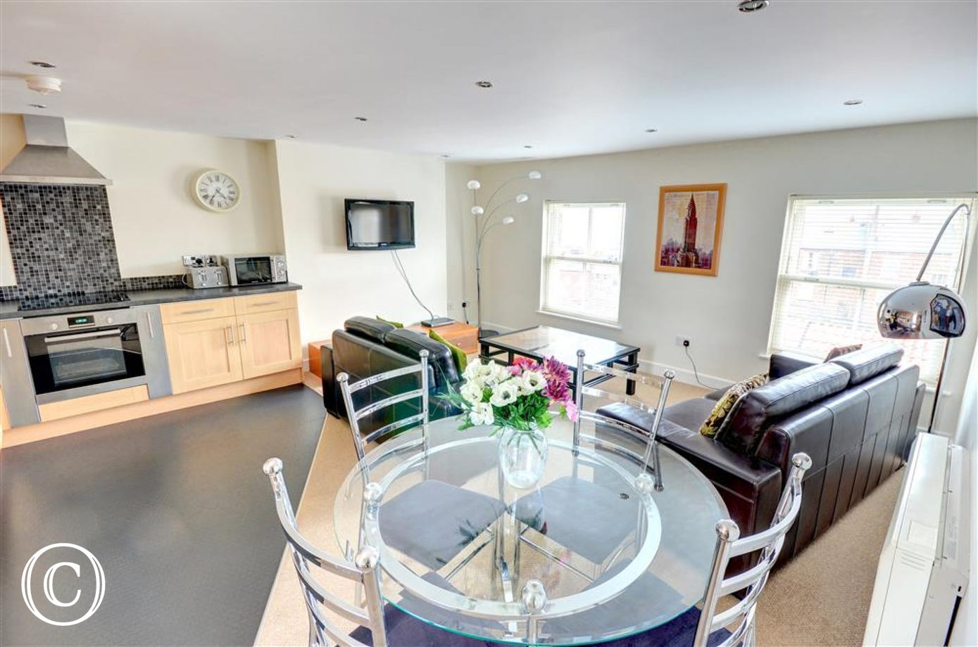Stylish, open plan Kitchen and Dining Area adjoined to the Lounge.