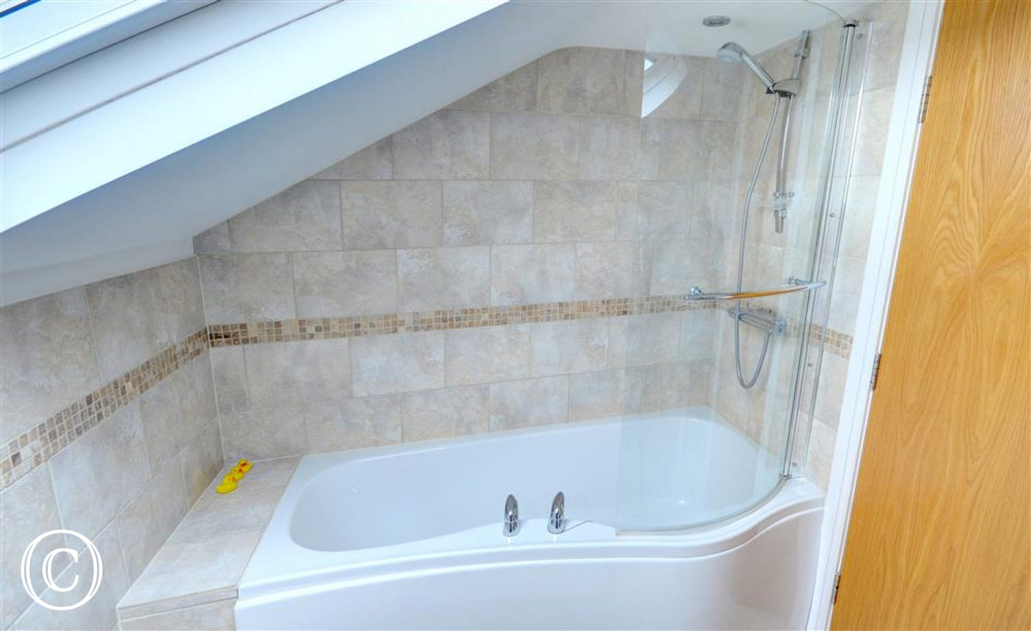 The Velux window in the Bathroom allows plenty of light in.
