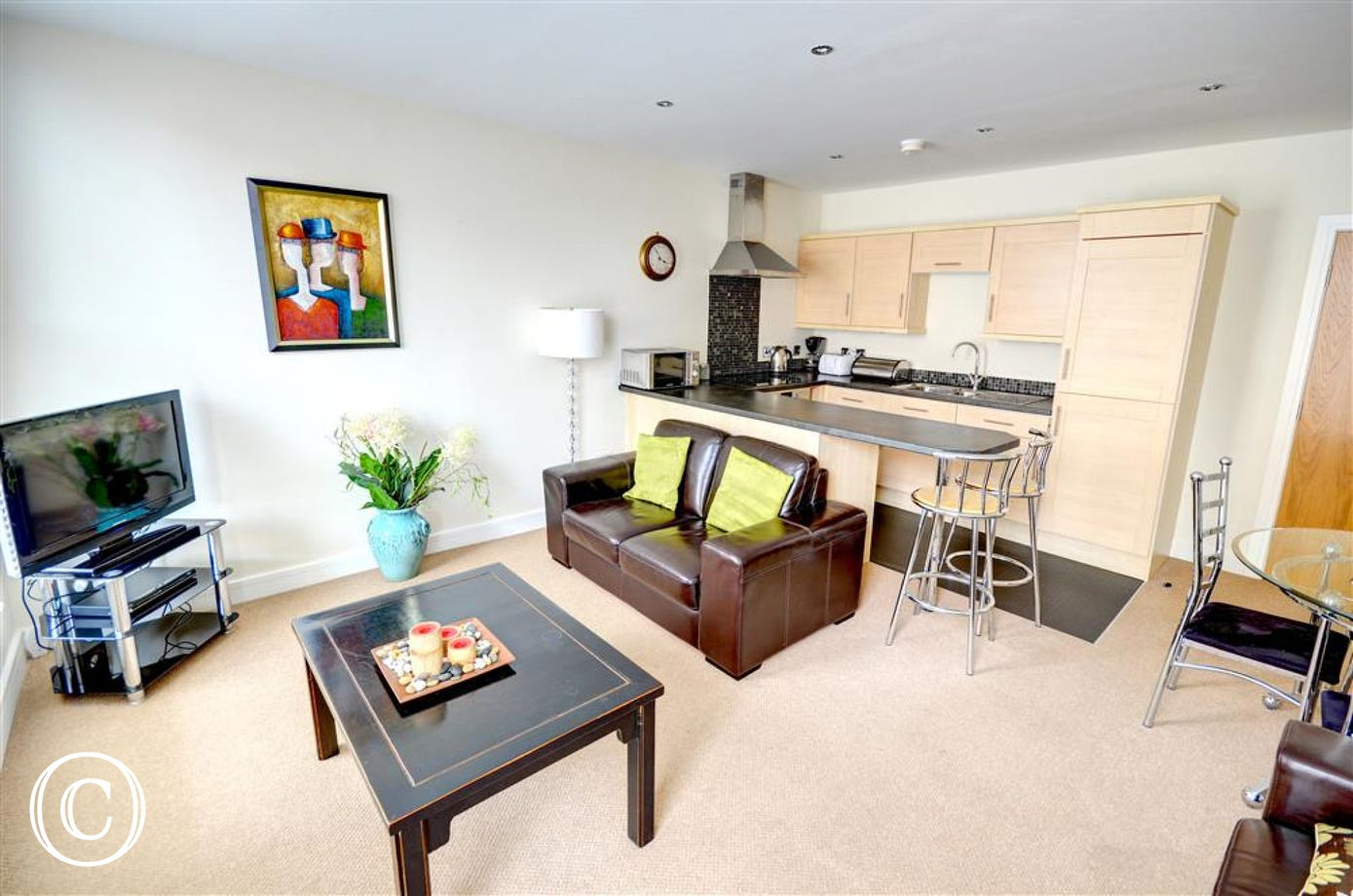 The comfortable Lounge Area is adjoined to the open plan Kitchen.