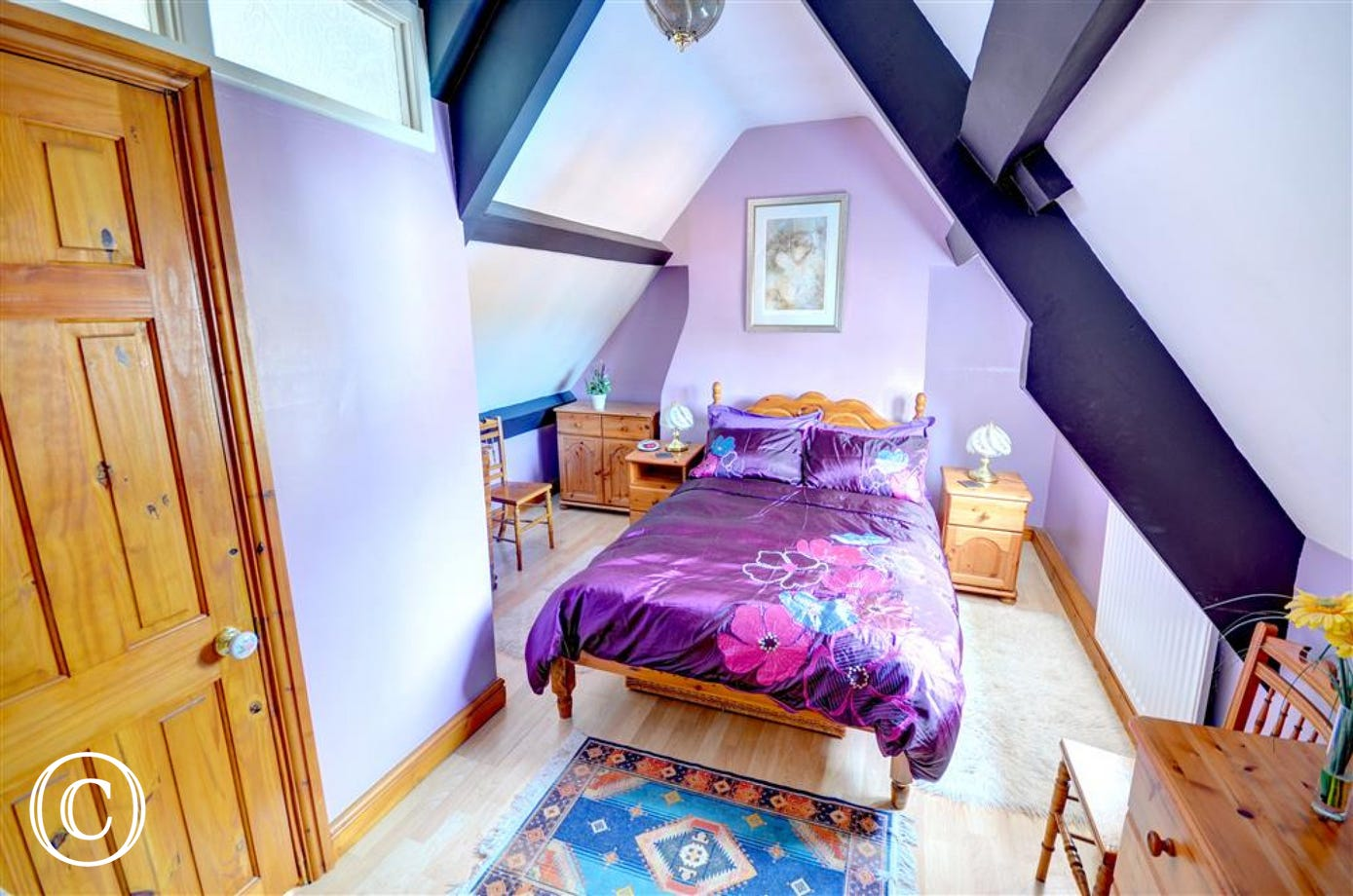 Attractive second floor bedroom which has views looking towards Whitby Abbey in the distance. There is also access to the En-suite Shower Room.