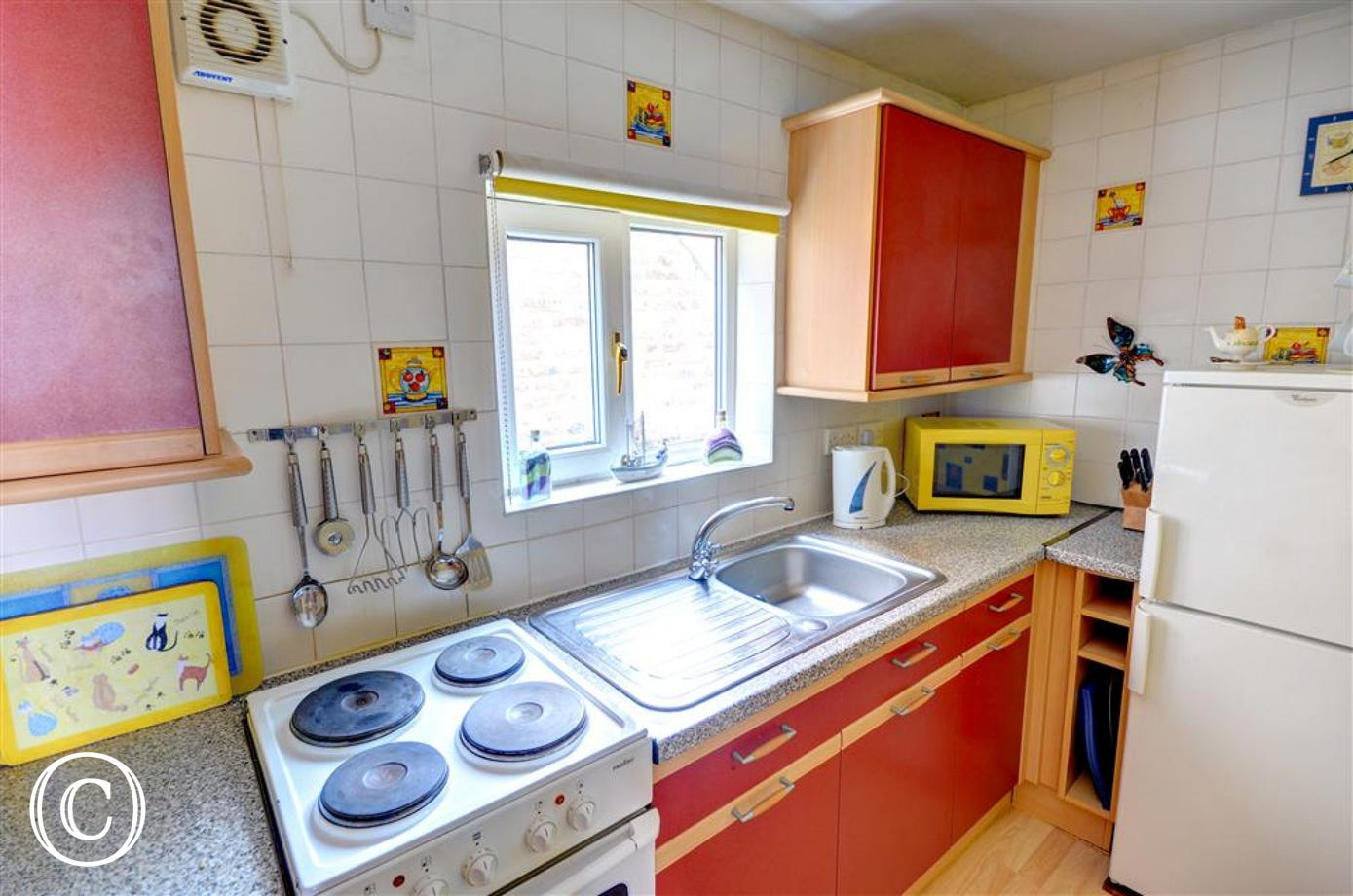 Compact yet well-equipped Kitchen.