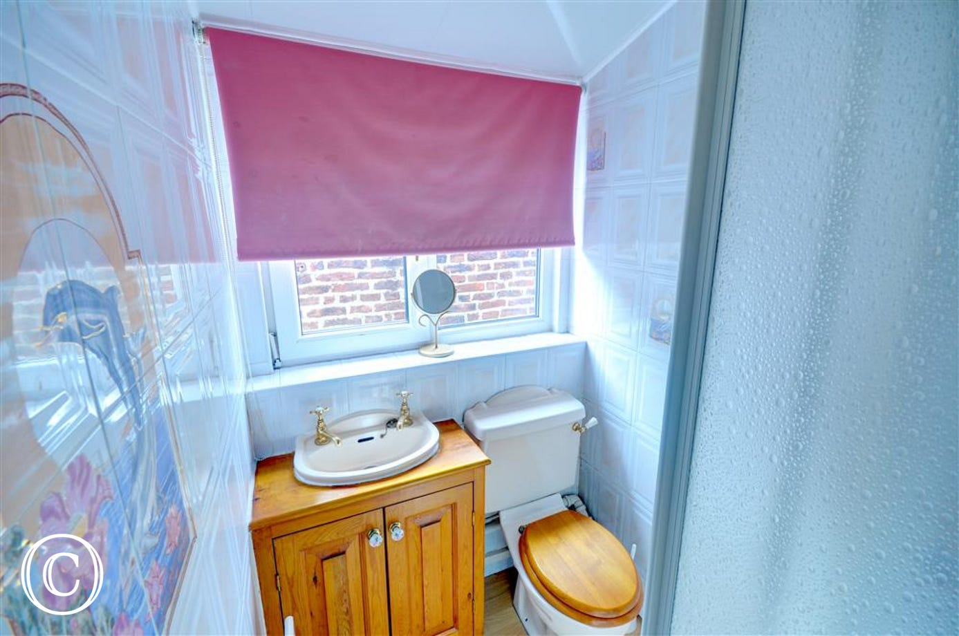 En-suite Shower Room which is accessed from the Bedroom on the second floor.