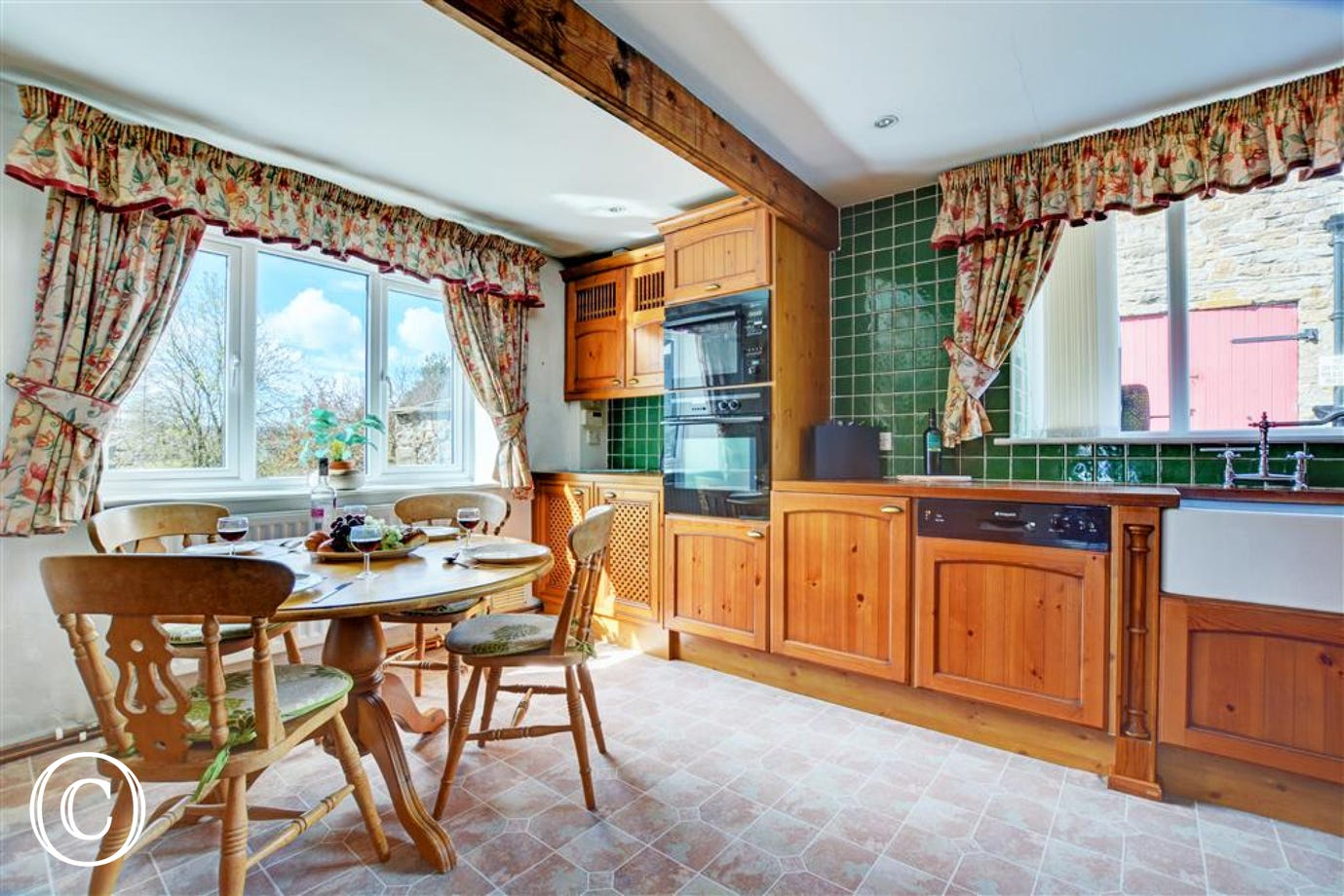 The kitchen and dining area at Orchard Cottage