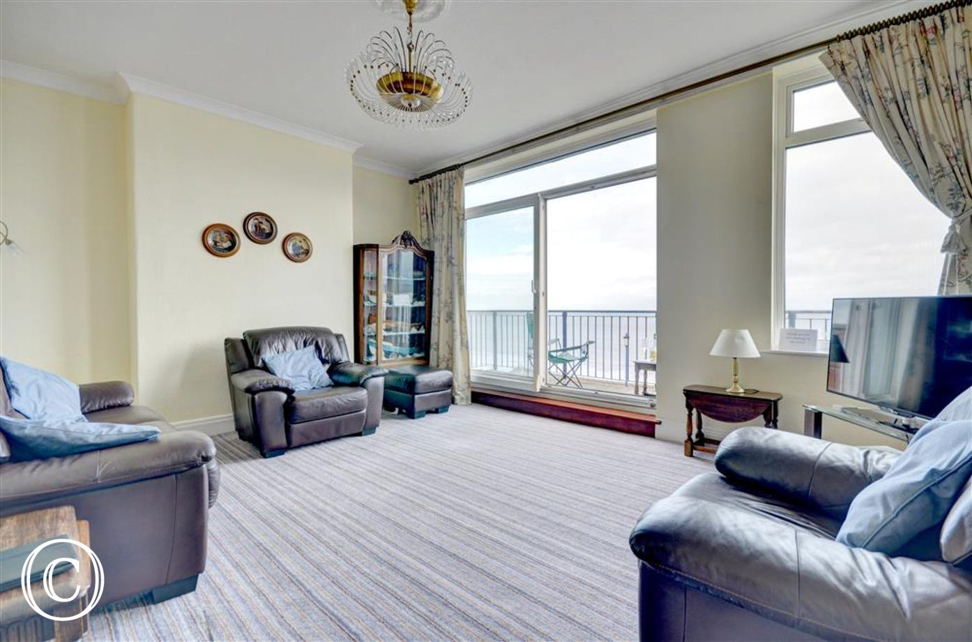 Large First floor living room has stunning views over the Bay.