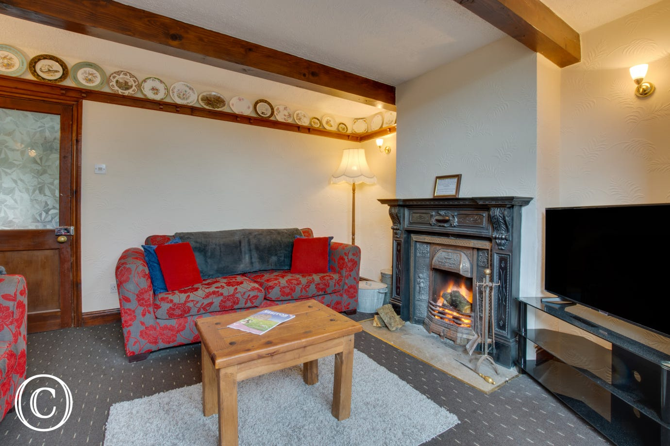 Spacious lounge with an open fire, nice and cosy