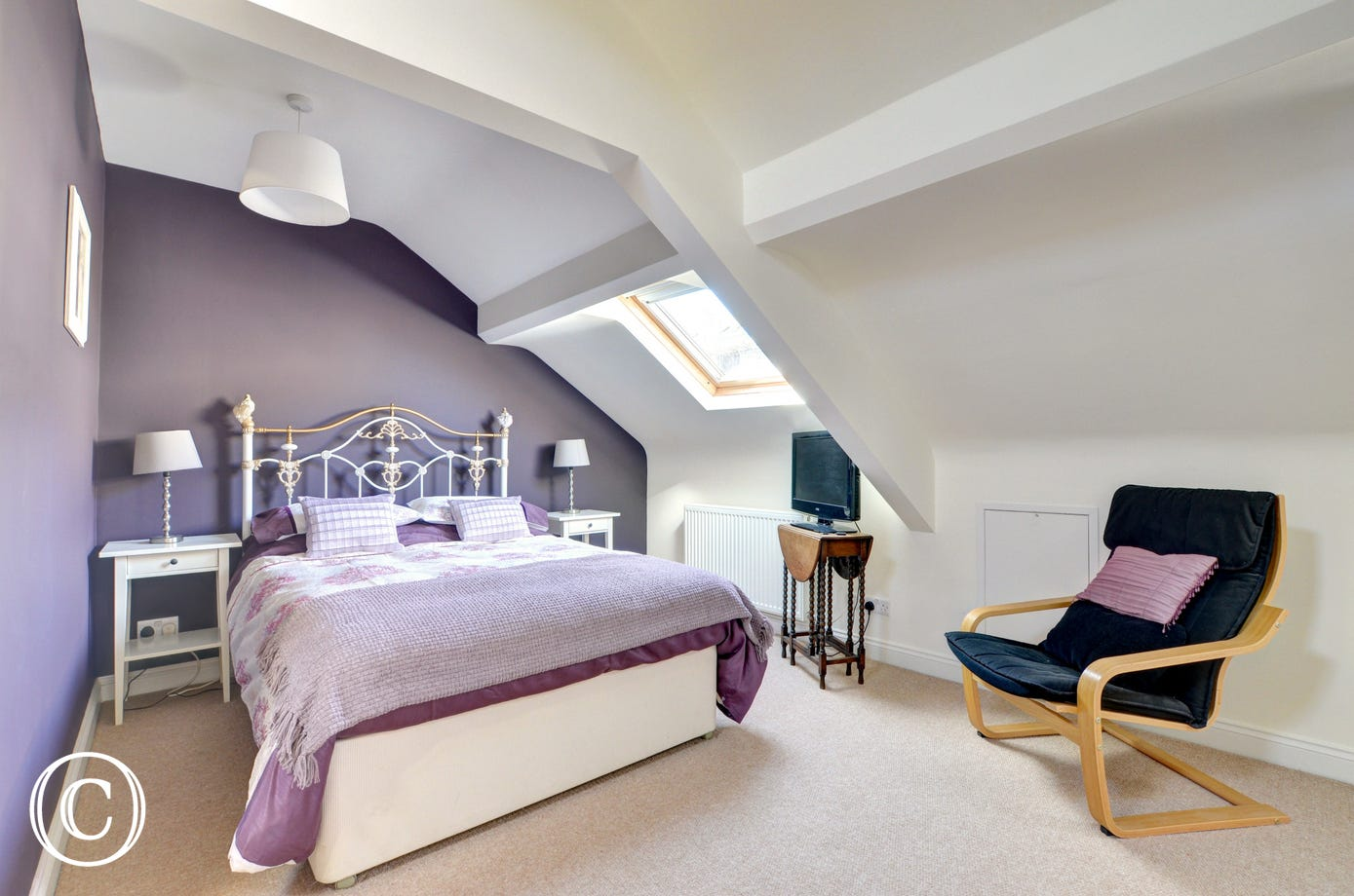 The bedroom benefits from velux windows.