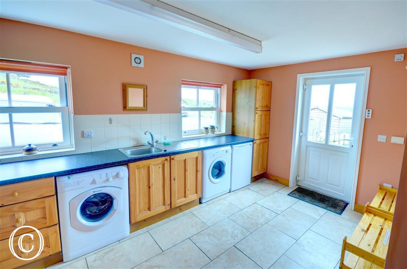 Large utility room offers some extra storage. Also there is a freezer, a washing machine and tumble dryer.