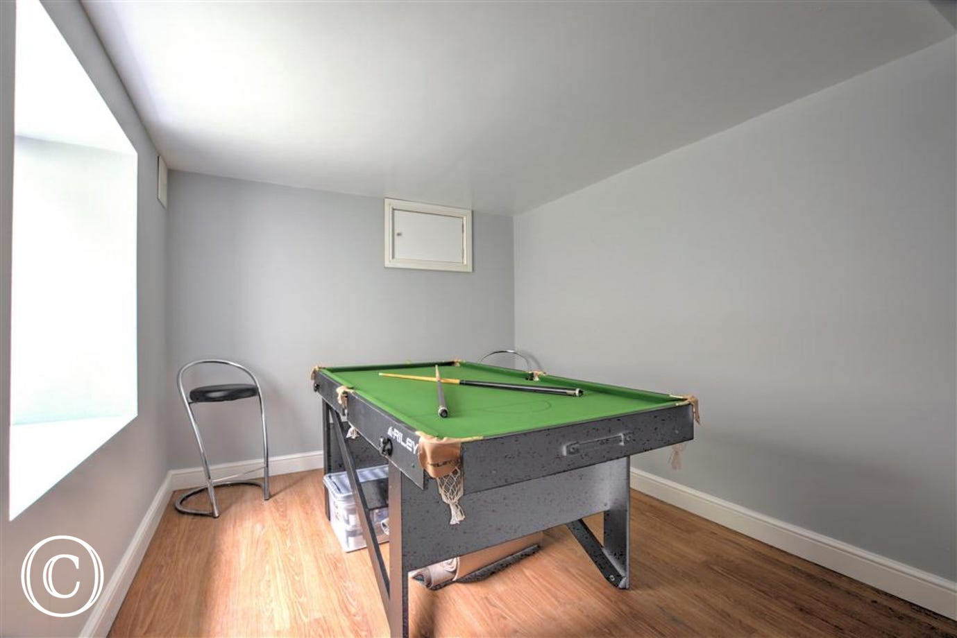 The games room has a pool table.