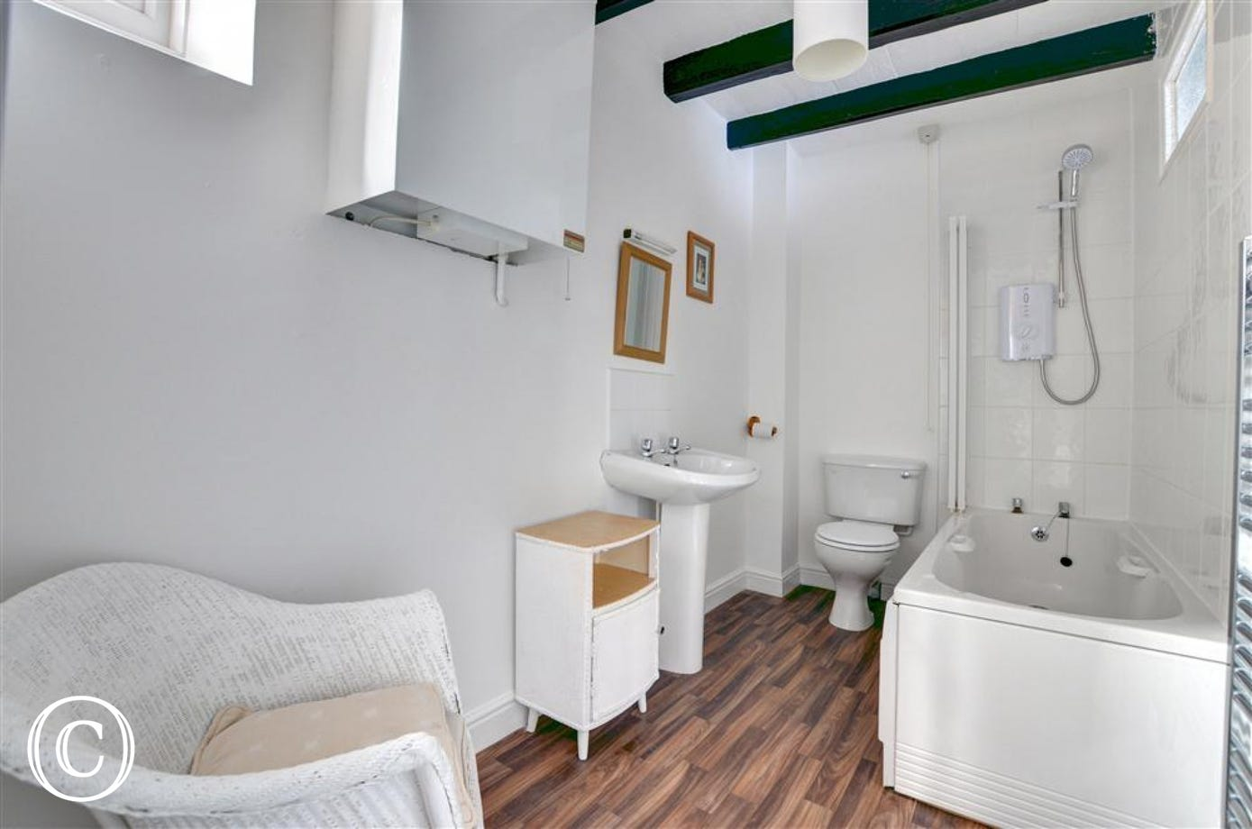 Good size family bathroom with bath and shower over the bath is located on the first floor.