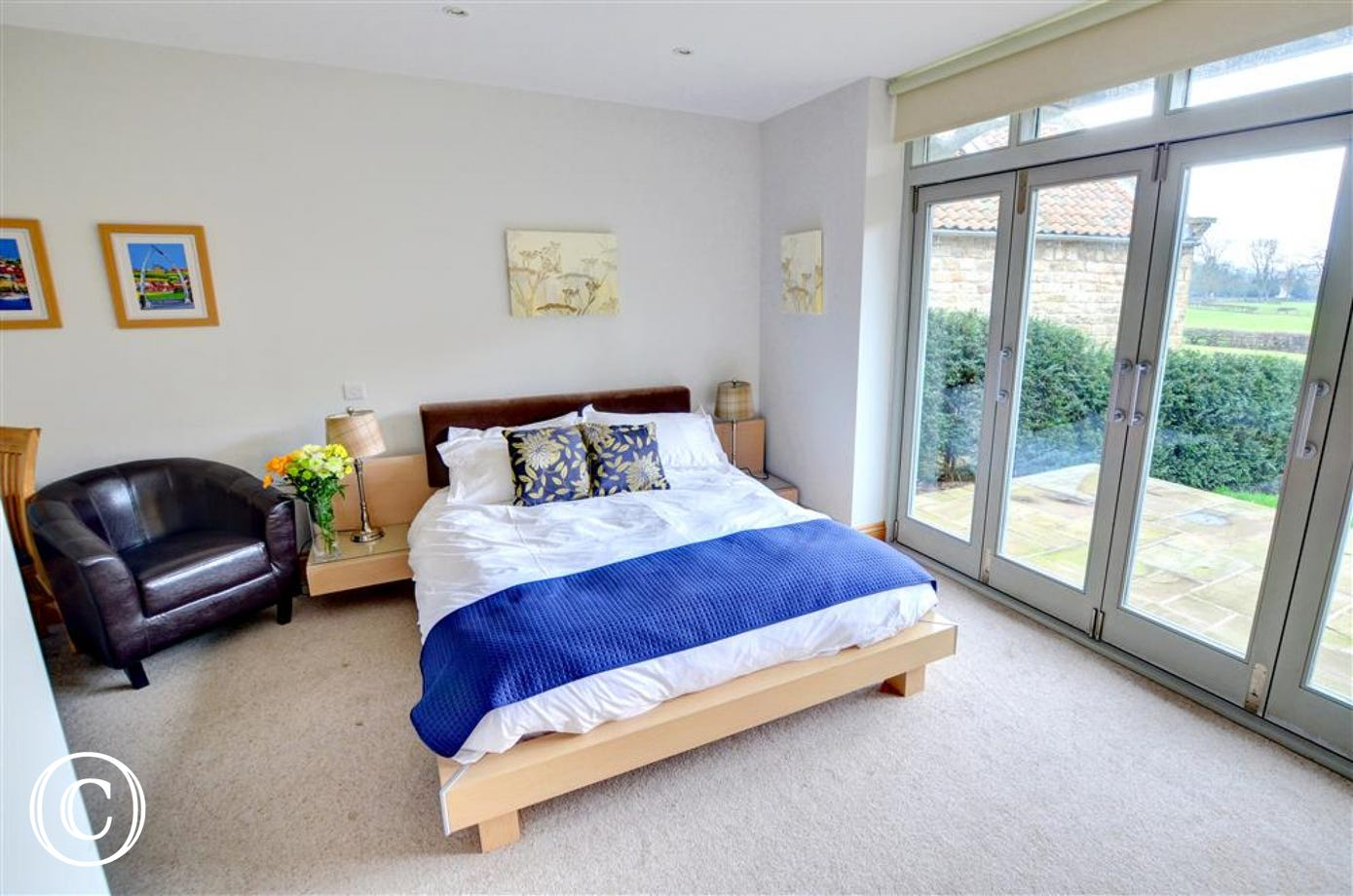 Bedroom is on the ground floor with some lovely views and doors leading out to the patio.