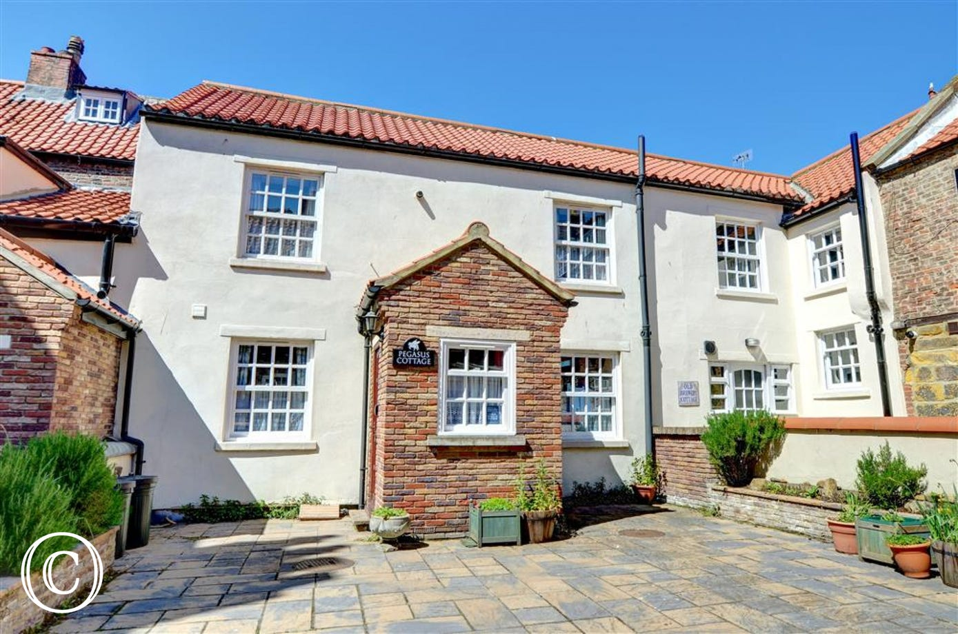 Exterior view of Pegasus Cottage which is located in White Horse Yard.