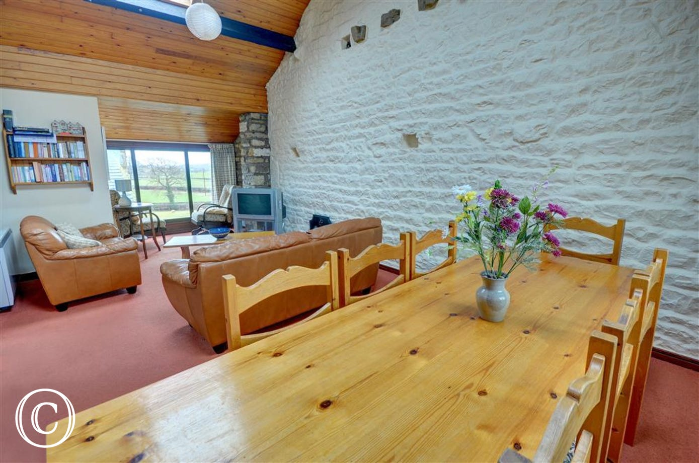 Dining area and lounge, with views over the open countryside.