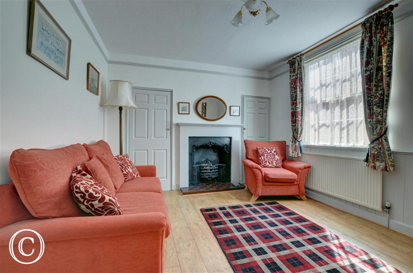 Comfortable ground floor sitting room boasting an original feature fireplace.
