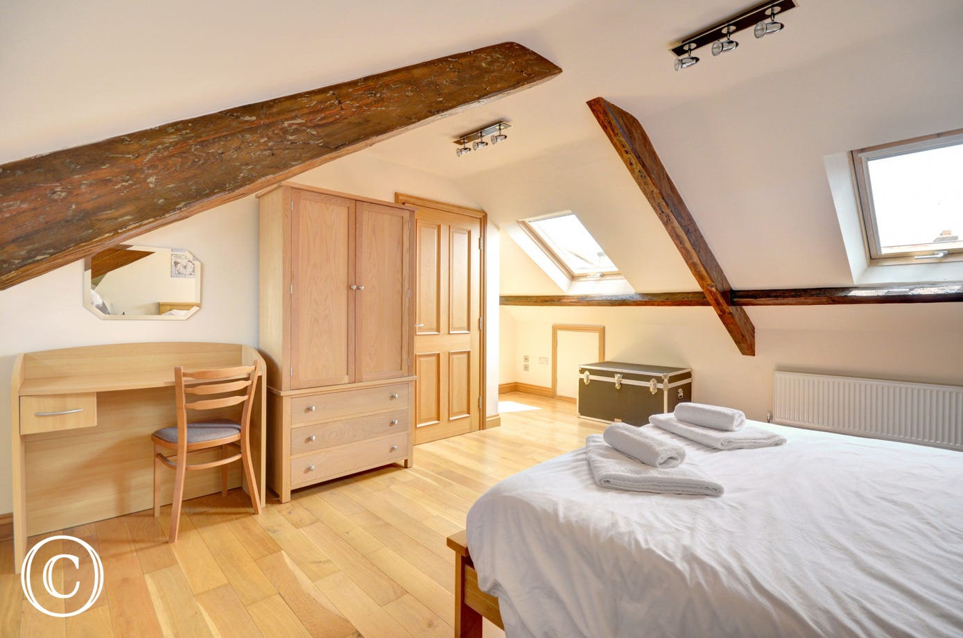 The master bedroom is light and spacious, with velux windows looking out across Whitby.