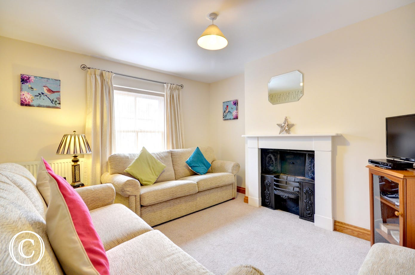 A snug and cosy lounge, ideal for reclining at the end of the day.